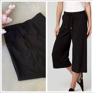 Black culottes with elasticated waist. Size XXL